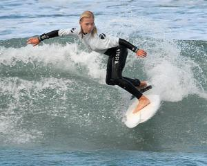Kyra Wallis (12), of Piha, competes in the under-12 division at the South Island Surfing...