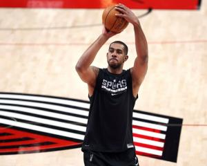 LaMarcus Aldridge shoots prior to one of his final games for the San Antonio Spurs, at his old...