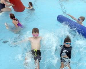 Mosgiel brothers Jay (9, left) and Jackson (6) Carter play at the Mosgiel pool on its final day...