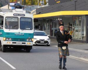 Keith Cameron, of Clyde, pipes Dora the digital bus down Tarbert St yesterday morning. Photos:...