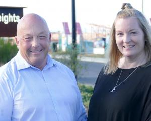 Clutha Mayor Bryan Cadogan and Plantation Heights sales co-ordinator Jo Jack stand in front of...