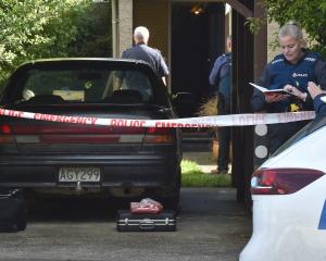 Dunedin police investigate a serious assault in North East Valley, Dunedin, yesterday. PHOTO:...