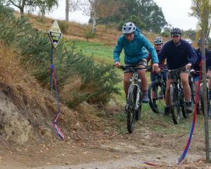 Kelvin Benny (15) leads a group of pupils who christened the new mountain bike track at  St Kevin...