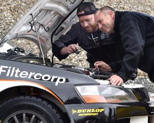 Otago Polytechnic automotive engineering student Rick McGuirk watches as New Zealand Rally...