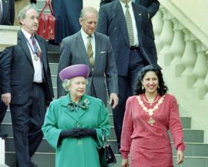 Dunedin mayor Sukhi Turner and the Queen walk down the Municipal Chambers steps in Dunedin in...