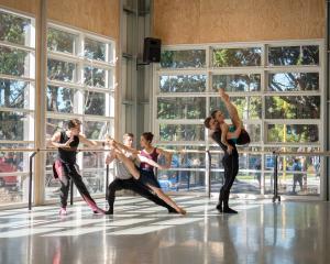 Choreographer Loughlan Prior (left) works with Royal New Zealand Ballet dancers on Ultra Violet....