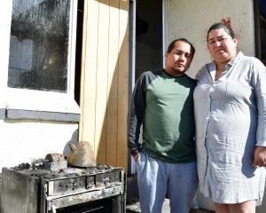 Elkin and Luisa Buitron outside their now uninhabitable Invercargill home. Photos: Laura Smith
