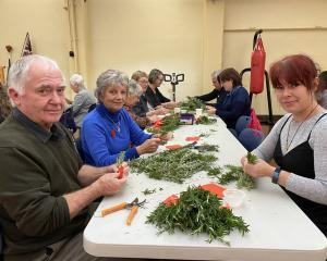 Joining volunteers at HMNZS Toroa in making about 4000 rosemary posies for Anzac Day were (from...