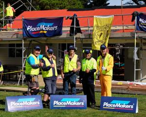 Taking a pause during the re-roofing of the league hall are (from left) Aramoana League vice...