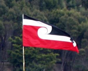 The Maori Tino Rangatiratanga flag flutters above Te Tii Reserve at Paihia as Waitangi Day...