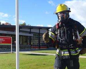 Volunteer firefighter Mark Basson trains for his world record attempt at running the fastest half...