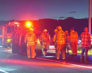 A car on its side on SH1 about halfway between Milton and Waihola at about 6.45pm tonight. PHOTO:...
