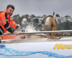H.A. Foote Haulage driver Ash Rogan fills up another tank of water in Midland St, Dunedin,...