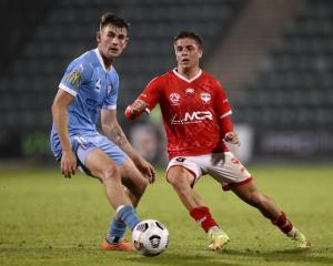 Cameron Devlin of the Phoenix competes with Connor Metcalfe of Melbourne City during their match...