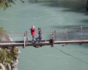 Kate Robinson and Cameron O'Keeffe during the proposal on Hokitika Gorge. Photo / Supplied