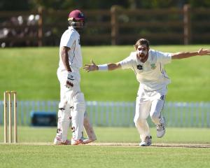 Otago wrist spinner Michael Rippon celebrates the wicket of Northern Districts batsman Brett...