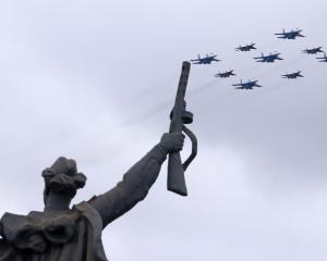 Russian jet fighters formation carry out a flypast, part of a military parade on Victory Day...