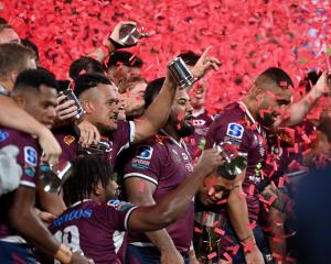 The Reds are all smiles after winning the Super Rugby AU competition last Saturday night.PHOTO:...