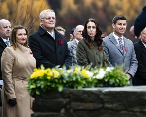 Attending a wreath-laying ceremony at the Arrowtown War Memorial yesterday are (from left) Jenny...