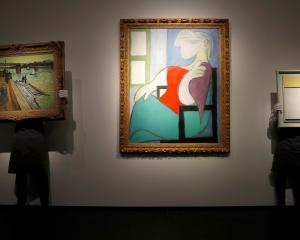 """Femme Assise Pres d'Une Fenetre (Marie-Therese)"" by Pablo Picasso (centre). Photo: Reuters"