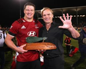 Crusaders' captain Scott Barrett and coach Scott Robertson celebrate winning the Super Rugby...