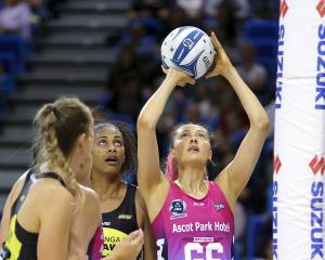 Steel shooter George Fisher looks to score watched by Pulse goalkeeper Kelera Nawai in an ANZ...