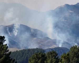 "A helicopter has been called in to help with a ""significant"" controlled burn-off in North..."