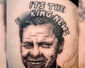 "The portrait of Gower - along with the phrase ""its the f**king news' - was inked by tattooist..."