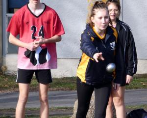 Beth Kirkpatrick (17), of Roxburgh Area School, throws a boule during a petanque game.
