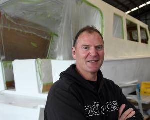 Sitting beside his long-running family boat restoration project is co-owner Andy Rich. PHOTO:...