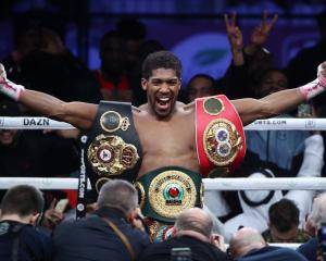 Anthony Joshua celebrates after beating Andy Ruiz to win back the heavyweight titles in his most...