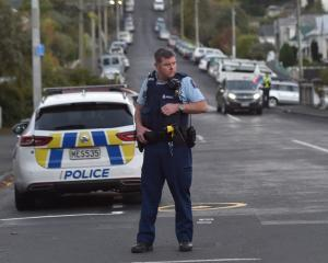 Police in North Dunedin following an alleged theft from a commercial premises. Photo: Peter McIntosh