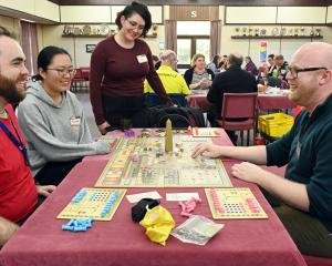 Chris Hay (right), of Dunedin, teaches Tekhenu to board game enthusiasts (from left) Matt...