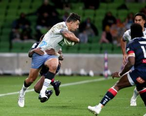 Bryce Heem of the Blues fends off a tackle in the match against the Rebels in Melbourne. Photo:...
