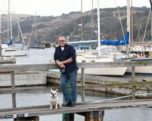 Sailor Chris King, of North Taieri, pictured with his dog Ted, backed calls for a harbour...