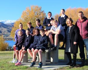 Encouraging the protection of Lake Dunstan's shoreline are (front, from left), Pixie Swain, Lily...
