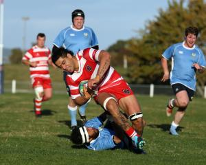 Clutha No8 Junior Samuelu crosses the try line on Saturday despite an attempt from Roxburgh back...