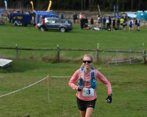 Richard Fogarty (Hill City-University, below) and Mandy Lowther (ultra distance section) compete...