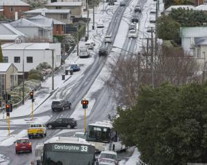 Traffic in Stuart St came to a standstill yesterday after motorists lost traction in the icy...