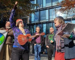 Protesters sing outside the Canterbury Regional Council office. Photos: RNZ