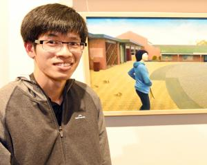 Auckland artist Gavin Chai (23) with his award-winning painting,  Howick. PHOTO: LINDA ROBERTSON