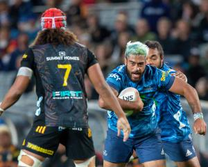 Akira Ioane runs the ball up for the Blues against the Chiefs. Photo: Getty