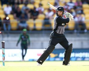 Glenn Phillips of New Zealand is bowled out during game one of the Twenty20 series between New...