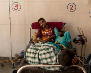 Patients receive treatment inside a Covid ward of a government-run hospital in Bijnor district,...