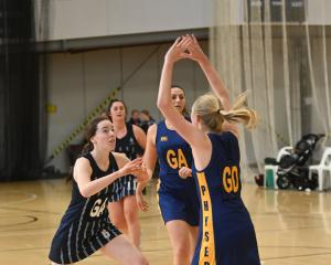 Hunting for the ball are (from left), St Hilda's Collegiate players Grace Southby and Brooke...