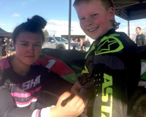 Double World Women's Motocross champion Courtney Duncan signs 9-year-old Cromwell fan Charlie...