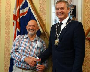 Ahuriri Community Board member Peter Ellis (left) is sworn on to the board by Waitaki Mayor Gary...