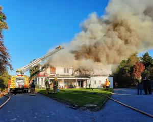 Fire crews work to extinguish a fire at Te Kiteroa Retreat & Historic Homestead in Waimate on...
