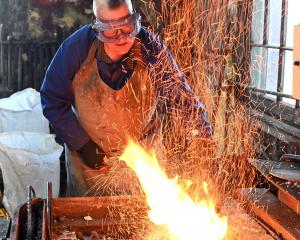 Dunedin builder and blacksmith Peter Mason operates a forge at the Dunedin Gasworks on Saturday,...
