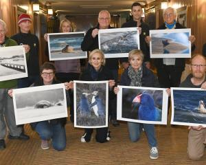 Participants in the New Zealand Photography Workshops Otago Peninsula tour show off their...